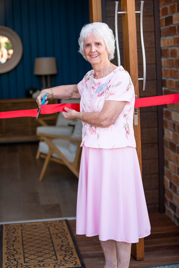 Cutting the red ribbon at the River House at Seachange Riverside Coomera